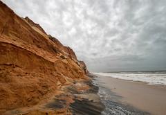 The land of cliffs (Chizuka2010) Tags: praiadafalésia albufeira portugal algarve travel travelphotography sandstone sandstonecliffs rocky rockformation rockstrata headland shore coastline clouds cloudysky erosion sand beach