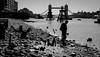 Looking for treasure (suzannesullivan2) Tags: thames london river water shore bridge towerbridge man blackandwhite
