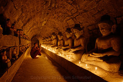 Passageway to Enlightenment (pdxsafariguy) Tags: burma myanmar mrauku monk asia temple buddhism religion ancient buddha travel old buddhist stone worship rakhine candle prayer praying brick statue shitethaung shitthaung passageway tomschwabel