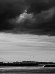 Ominous Clouds Over the Gulf Islands From Mt. Douglas (Portrait) (Paul T. Marsh/PositivePaul) Tags: olympus40150mmlens paultmarsh leicad3 leicadigilux3 canadianislands april2018 britishcolumbia sea wwwpaulmphotographycom blackwhite victoriabc monochrome vancouverisland clouds lightroomcc telephoto paulmarshphotography canada pacificnorthwest 2018 springvacation waterways