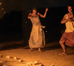 Dancing by the desert fire, until the starts would fall of desire (ybiberman) Tags: israel desert festival rainbowserpentfestival woman dancing dust fire bonfire night portrait candid streetphotography people