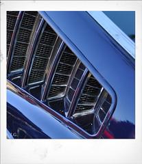 Jus_Polaroids01 (reinhard_srb) Tags: artwork polaroid automarke automobil oldtimer ausstellung logo farbe fahrzeug historisch detail karosserie blech lack design spiegelung glanz sammler ford mustang blau lüftungsschlitze gitter zierleiste