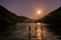 If you want to shine like a sun, first burn like a sun. A. P. J. Abdul Kalam (Lorrainemorris) Tags: lorrainemorris sunburst summer landscape candid creative artistic woods trees light water happy zeiss 7rm2 sony sky play splash silhouette ireland wicklow glendalough mood colours lake sunrays fun kids starburst sun