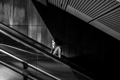escalator phonegirl (christiankremsner) Tags: vienna black white schwarz weis austria wien 2018 girl with iphone escalator monochrome shadow