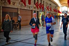 A woman and a man running in old bazaar during Bursa Osmangazi Historical City Run tha took place in April 14, 2018 (CamelKW) Tags: 2018 bursa turkey