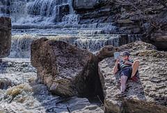 Enjoying a Good Read (Paul B0udreau) Tags: nikkor50mm18 photoshop canada ontario paulboudreauphotography niagara d5100 nikon nikond5100 rockway falls water rocks person book reading waterfall pelham