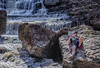Enjoying a Good Read (Paul B0udreau) Tags: nikkor50mm18 photoshop canada ontario paulboudreauphotography niagara d5100 nikon nikond5100 rockway falls water rocks person book reading waterfall pelham