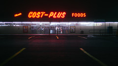 Cost-Plus (BurlapZack) Tags: panasoniclumixgh2 panasonicleicadgsummilux25mmf14 vscofilm pack07 dallastx oakclifftx elrodscostplusfoods groceries grocerystore night latenight closed parkinglot fog foggy neon neonsign neighborhoodgrocery americana smalltownamerica haze glow availablelight lowlight highiso cinematic wimwenders fluorescent 169 16x9 widescreen dark nighttime