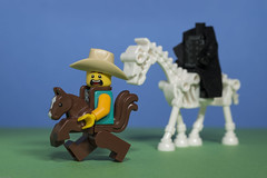 The Cowpoke is being chased by the Headless Horseman --- Full Speed ahead !! (N.the.Kudzu) Tags: tabletop lego minifigures cowboy headlesshorseman primelens canondslr canon50mmf18 canoneflens canon430ex flash