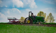 On Steel (Images by MK) Tags: amish mennonite church religion field fieldwork farm farming tillage tractor johndeere jd plowing plow earth dirt crop spring springtime rural agriculture trees sky blue green steel tires rough wheels iowa amana johndeere6300 6300