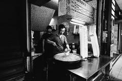 Dishing it out (D. R. Hill Photography) Tags: taipei taiwan asia capital urban city food foodstall streetfood street streetphotography people cooking cook chef blackandwhite monochrome nikon nikond750 nikon20mmf18g nikon20mm 20mm primelens fixedfocallength wideangle