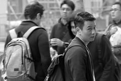 Annoyed (TheseusPhoto) Tags: monochrome blancoynegro blackandwhite noir bnw streetphotography street candid people city citylife guy annoyed
