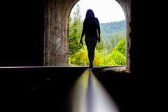 She Bought a Ticket and Vanished in the Sky (Thomas Hawk) Tags: america glendale julia juliapeterson oregon southernoregon usa unitedstates unitedstatesofamerica mrsth silhouette spouse traintracks tunnel wife fav10 fav25 fav50 fav100