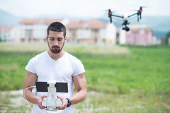 Man Controls Drone in Nature - Credit to https://www.thehousewire.com/ (TheHouseWire) Tags: air aircraft drone propeller quadcopter quadrocopter remote robot rotor camera copter above flight fly helicopter adult aerial aviation control controlled device digital equipment hand hobby innovation male man modern motion multicopter multirotor outdoor people person photo photography pilot playing professional sky spy technology uav unmanned vehicle video wireless summer