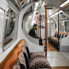 Tuned In (Sean Batten) Tags: london england unitedkingdom gb londonunderground underground metro subway tube person candid carriage bakerlooline reflection window nikon d800 35mm seat
