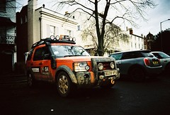 ot500 - cool land rover (johnnytakespictures) Tags: olympus trip500 compact automatic film analogue lomo lomography xprochrome100 xpro crossprocessed crossprocess 35mm leamingtonspa landrover discovery truck car vehicle transport orange challenge street cool rally leamington