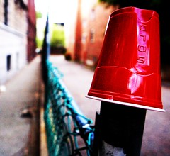 Cup on a Post (scotersen) Tags: red party slr cup beer boston digital d50 garbage nikon angle massachusetts wide gimp parties wideangle 2006 nikond50 plastic cups solo rubbish waste filth nikondigital allston redcup plasticcup nikonslr 14mm nikondigitalslr