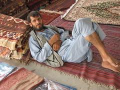 Rug Dealer (Palmer Digital Studio) Tags: people afghanistan man canon person is powershot rugs merchant seller s2 dealer rugdealer