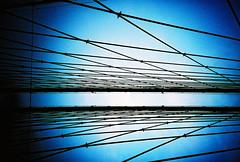 brooklyn bridge (lomokev) Tags: blue sky newyork brooklyn lomo lca xpro lomography crossprocessed xprocess cable lomolca brooklynbridge agfa vignetting jessops100asaslidefilm agfaprecisa lomograph agfaprecisa100 cruzando precisa jessopsslidefilm cabls rota:type=showall rota:type=perspective rota:type=composition rota:type=silhouette rota:type=cityscape rota:type=stilllife rota:type=lightingexsposure file:name=lomo0806e51 use:on=moo posted:to=tumblr