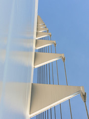 Sundial in Blue (Vicki & Chuck Rogers) Tags: california bridge sky detail reflection photo graphic suspension cable redding santiagocalatrava sacramentoriver novideo sundialbridge photosonly