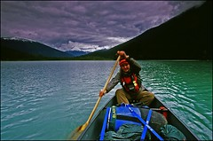 Crossing Lanezi (_Jezza_) Tags: mountains film nature girl clouds canon bc britishcolumbia lakes paddle ishootfilm canoe adventure velvia canoeing slides paddling canoetrip canonfilm filmphotography paddler ak10 spacesfornature lpbesttravel