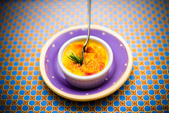 szechwan peppercorn creme brulee (Splat Worldwide) Tags: blue food orange canon wow studio eos pattern purple circles gorgeous plate spoon battle creme rosemary 5d dots peppercorns 50mmf14 brulee alienbees szechwan