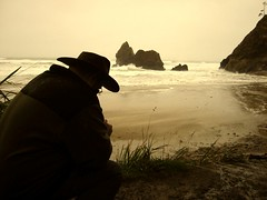 Picture of Chris taking a picture on the Oregon coastline (mikeyexists) Tags: ocean sea oregon portland photography coast waves passionphotography