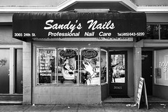 Nails, waxing and more (PeterThoeny) Tags: missiondistrict sanfrancisco california siliconvalley sanfranciscobay sanfranciscobayarea shop nails waxing beautyshop outdoor flickr photowalk muralmissionphotowalk2018 monochrome blackandwhite sony sonya7 a7 a7ii a7mii alpha7mii ilce7m2 fullframe fe2870mmf3556oss raw photomatix hdr qualityhdr qualityhdrphotography fav100