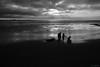 Strolling at Low Tide (ian_underthesea) Tags: beach low tide blackandwhite bw morning silhouette