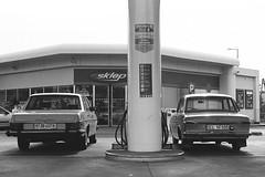 Filling Station (piotr_gaczkowski) Tags: filling station gas mercedes w115 taunus ford 12m bp łódź drewnowska bw monochrome kodak 400tx trix analog film