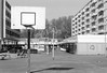 The square (onemanifest) Tags: amsterdamwest architecture sixties square apartmentbuilding neighbourhood district sunlight shops analog film monochrome blackwhite minoltaxd7 minoltamdrokkor85mm117 ilforddelta100