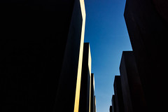 Out of the darkness (Explored) (Barrie T) Tags: holocaustmemorial berlin silhoutte shapes graphic blue sky