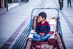 Shiraz boy, Iran 2018 (PaxaMik) Tags: shiraz chiraz iran travelinginiran boy portrait worldportraits streetphoto street streetphotography streetlife colors carpet tapis pink