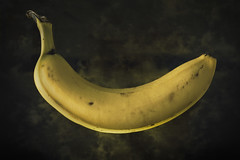Banana (finding_fl) Tags: canon canon70d 70d 2018 florida ocalaflorida 1852 52weeksof2018 52weeksproject banana floating food floatingfood color yellow studyinthecoloryellow offcameraflash stilllfe 50mm canon50mm gelledflash grungy