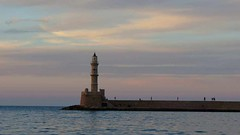 the Chania lighthouse at sunset IMG_0449 (mygreecetravelblog) Tags: greece crete greekisland greekislands island chania hania xania city town outdoor landscape harbour harbor harbourfront bay water sea waterfront lighthouse chanialighthouse venetianlighthouse tower architecture buildings