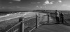 Big Monday (OzzRod (on the road again)) Tags: pentax k1 hdpentaxdfa1530mmf28 monochrome blackandwhite seascape surf sea breakers viewingplatform fence tourists beach shoreline barbeach newcastle dailyinmay2018
