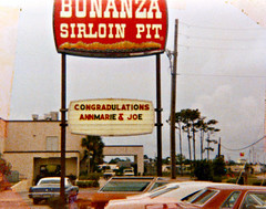 Bonanza Sirloin Pit (1971) (Brett Streutker) Tags: restaurant cafe diner eatery food hamburger cheeseburger eat fast macdonalds burger vintage colonel sanders kentucky fried chicken big mac boy french fries pizza ice cream server tip money cash out dining cafeteria court table coffee tea serving steak shake malt pork fresh served desert pie cake spoon fork plate cup drive through car stand hot dog mustard ketchup mayo bun bread counter soda jerk owner dine carry deliver monochrome people photo