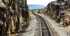 Train Tracks (Eyes Open To Life) Tags: tracks train rocky rockformation travel rugged barren traintracks landscape ngc