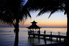 Good Night Jamaica! (Poocher7) Tags: sunset palmtrees pier gazebo people reflections silhouettes waves peaceful night ropes posts ripples lovely beautiful pretty water ocean caribbeansea jamaica westindies caribbean