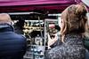 Coffee Vibes (Peter Glaab) Tags: 25mm fischmarkt hamburg olympus stpauli street zuiko f18 m43 kaffee coffee frau marktstand smartphone display