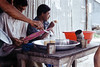 Tea - A staple Drink (Sheikh Shahriar Ahmed) Tags: dhakadivision jamalpur melandaha tea teastore teaseller candid drink refreshment lifestyle rural bazaar village stall bangladesh sheikhshahriarahmed film fujifilm fujicolorc200 analog nikon nikonf80 n80 af50mmf18d 50mm pacificimage primefilm3650pro3 originalphotographers travel travelphotography