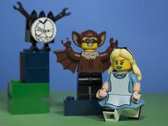 Alice is passing through one of the scarier sections of Wonderland (N.the.Kudzu) Tags: tabletop lego minifigures monster manbat aliceinwonderland primelens canon50mmf18 canondslr flash lightroom