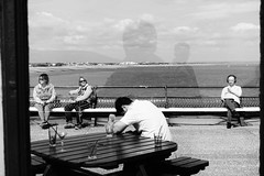 Pier Group (Henry Hemming) Tags: people pier individuals alone group drink bar sunny melancholy bw mono