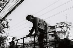 Untitled (D. R. Hill Photography) Tags: bangkok thailand asia southeastasia street streetphotography blackandwhite monochrome man person grain analog film 135 35mmfilm contax contaxg1 g1 carlzeissplanar35mmf2 zeiss planar 35mm primelens fixedfocallength city urban kodak kodakfilm kodaktrix400 trix