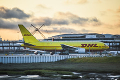 dhl 1917 departs for los angeles (pbo31) Tags: bayarea california nikon d810 color may 2018 spring boury pbo31 sunset sanfranciscointernational sfo sanmateocounty millbrae airport airline aviation travel plane dhl takeoff runway yellow sky freight