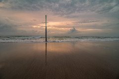 Solo (tshabazzphotography) Tags: sea sunset sky beach ocean water pier pole stick solo alone sand waves clouds cloudy sunrise explore morning adventure lowtide tide reflection wideangle canon