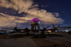 ready alert. tucson, az. 2015. (eyetwist) Tags: eyetwistkevinballuff eyetwist night dark urbex abandoned nose cockpit magenta boeing kc97 stratofreighter tanker lightpainting interior airplane aircraft arizona tucson boneyard graveyard nikkor nikon d7000 1024mm 1024mmf3545g arid fullmoon longexposure moonlight npy nocturne workshop desert sonorandesert rusty rust decay hulk wrecked dented metal dusty derelict junkyard old scrap storage amarg amarc davismonthan afb kc97g usaf airforce cargo freighter engines fuel coldwar airtoair refueling gasstationinthesky american west lastflightout propeller windows startrails polaris northstar fuselage 522604
