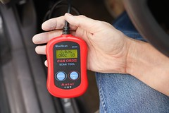 OBD-II scan tool with CAN OBDII MaxiScan MS300 from Autel (yourbestdigs) Tags: obd2 scanner obdii scan car eobd ce fcc recycle red mechanic blue jeans denim hand plug scanning error codes emissions test testing v3