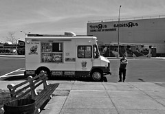 Softee (Robert S. Photography) Tags: street bw monochrome icecreamvan softee man standing stores toysrus goingoutofbusiness sign bench trashcan spring brooklyn newyork caesarsbay sony dscwx150 iso100 may 2018