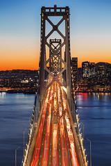 Bay Bridge at Sunset - #1 (Manol Z. Manolov) Tags: baybridge bayarea sanfrancisco california landscape city urban cityscape suspensionbridge rushhour traffic sunset bluehour pacific ocean lights bridge cars vehicle bay
